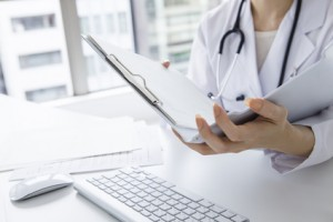 Woman doctor looking at medical records