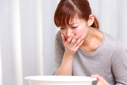 vomiting woman