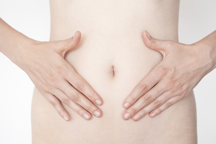 Woman's hands on stomach