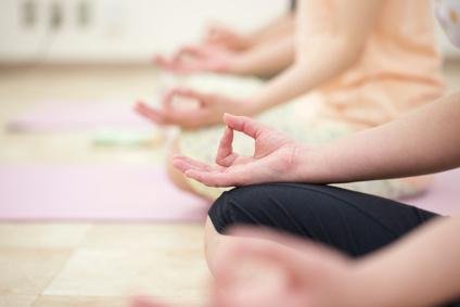 Young women do yoga indoors